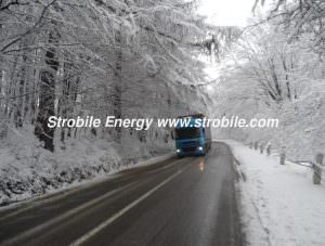 A truck of Virgin Wood Pellets Silver Fir is rushing through a winter forests of Bukovina to retail consumers